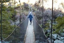 Justine Tyerman manages to cross the swing bridge over the Matukituki River. Photo / Chris Tyerman