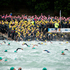 Swimmers wade into the water for the start of the New Zealand Ocean Swim Series, Harbour Crossing. Photo / Dean Purcell
