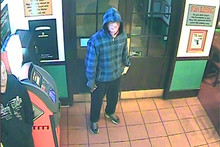 This man is among those thought responsible for armed robberies at five bars or restaurants in eastern Auckland. Photo / Supplied