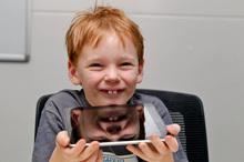 Eamon Rooney tests the Apple iPad. Photo / Michael Craig