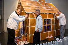 Te Papa chefs (from left) Bernd Lippmann, Paul Limacher and Tom Brinkel decorate their gingerbread creation.  Photo / Mark MItchell