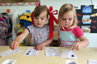 Bella Neville, left, and Grace Cameron of Lakeview Kindergarten count to improve their maths skills. Photo / Doug Sherring