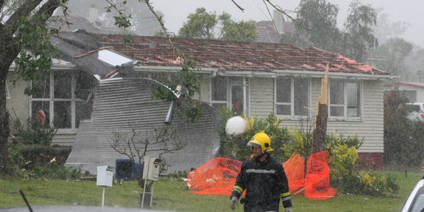 Loading Devastation on Wallington Way, Hobsonville this afternoon after a tornado ripped through.  Photo / Chris Gorman
