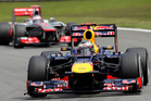Red Bull driver Sebastian Vettel of Germany, front, steers his car ahead of McLaren Mercedes driver Jenson Button of Britain during qualifying at Interlagos in Sao Paulo, Brazil. Picture / AP