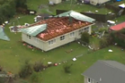 The tornado ripped the roof from this house in Hobsonville. Photo / One News