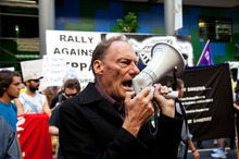 Veteran activist John Minto in action at the anti-TPPA protest. Photo / Neville Marriner