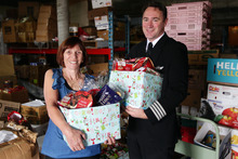 City Mission boss Diane Robertson and Jetstar chief pilot Richard Falkner launch the Christmas appeal. Photo / Doug Sherring