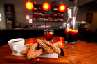 Churros with chocolate sauce and a jug of sangria at Basque Kitchen and Bar. Photo / Steven McNicholl