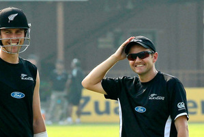 Mike Hesson, right, smiles as he talks to player Trent Boult during a cricket practice session in, Sri Lanka. Photo / AP