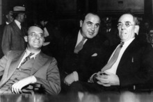 Al Capone, with his defence attorneys Michael Ahern (left) and Albert Fink (right), had plenty of reasons to smile. Photo / Supplied