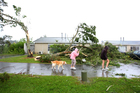 Devastation was everywhere on Wallingford Way in Hobsonville yesterday afternoon. Photo / Chris Gorman