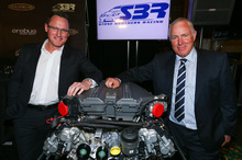 Ross Stone (right) with Erebus Motorsport chief Ryan Maddison and the Mercedes engine the new SBR car will use. Photo / Supplied