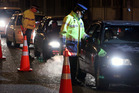 Police pictured at drink drive check point after the Rugby World Cup final in Auckland. Winscribe's software was used by polic to help spend more time in the field. Photo / Glenn Taylor