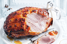 This classic glazed ham teams with the bright pop of dried cranberries for a festive touch. Photo / Benjamin Dearnley