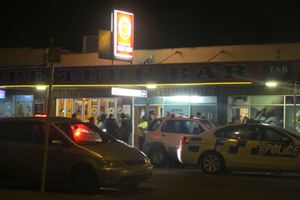 Police and patrons outside the Kope Turf Bar just after an attempted armed robbery. Photo / The Daily Post