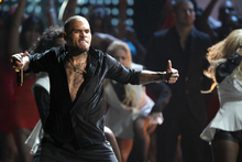 Chris Brown performing at the American Music Awards. Photo/AP