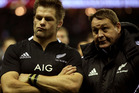 Richie McCaw of New Zealand and Steve Hansen head coach of New Zealand look on after defeat during the QBE International match between England and New Zealand. Photo / Getty Images.