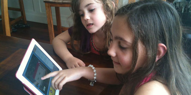 Micahel Gifford's granddaughters Sofia (l) and Julia playing the 7 Wonders of the World game. Photo / Supplied