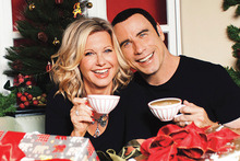 Olivia Newton-John and John Travolta in the cover image for This Christmas.