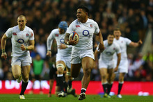 Manu Tuilagi of England runs through to score his try during the match between England and New Zealand. Photo / Getty Images 