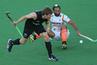 James Coughlan of New Zealand and Sardar Singh of India collide as they contest for the ball. Photo / Getty Images