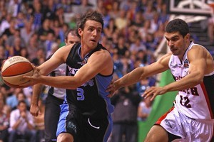 Daryl Corletto of the Breakers runs the ball past Kevin Lisch of the Wildcats. Photo / Getty Images