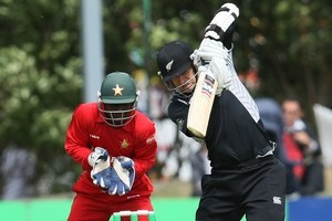Nathan McCullum of New Zealand plays to the onside against Zimbabwe. Photo / Getty Images