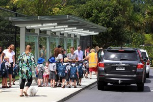 Boys wait to be picked up by their parents from St Kentigern School. Photo / Doug Sherring