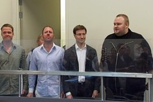 Kim Schmitz aka Kim Dotcom (far right) and his three co-defendants. Photo / 3News