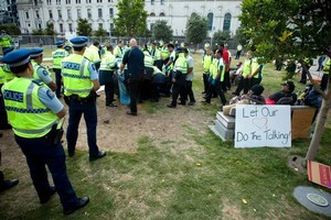 Security staff and police removed Occupy Auckland protestors from Aotea Square late last month. Photo / Dean Purcell