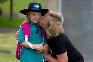 Katie Tyrrell, 5, gets a good send-off from her mum Sue as she prepares to start at Long Bay Primary School. Photo / Brett Phibbs