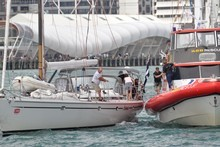 Crew of the yacht Antaeus transfer the hurt woman to a Coastguard vessel. Photo / Dietmar Petutschnig