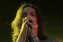 Incubus front man Brandon Boyd plays to a large crowd at Vector Arena. Photo / Greg Bowker