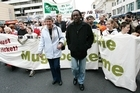 Henry Olonga leads a protest march. Photo / Chris Skelton