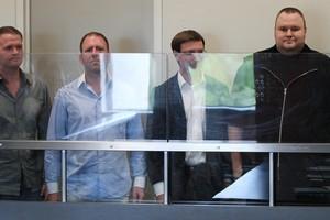 Bram van der Kolk, Finn Batato, Mathias Ortman and Kim Dotcom at the North Shore District Court. Photo / Greg Bowker
