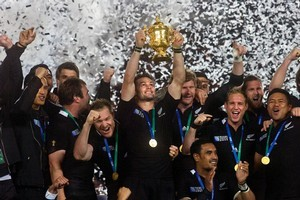 Captain Richie McCaw lifts the William Webb Ellis trophy at the end of the Rugby World Cup. The trophy will travel around New Zealand over the next two months. Photo / Andrew Warner