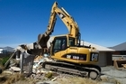 Homes in the Christchurch suburb of Bexley are now being demolished. Photo / Simon Baker