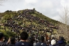 A crowd gather on Taupiri Mountain to pay their respects to Te Arikinui Dame Te Atairangikaahu. Photo / NZPA