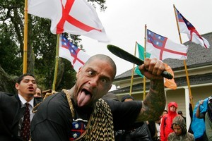 A Maori protester pokes out his tongue while marching on the Treaty Grounds during celebrations for the Treaty of Waitangi, New Zealand. Photo / NZPA