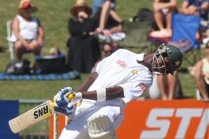 Zimbabwe's Forster Mutizwa ducks a bouncer from New Zealand's Doug Bracewell. Photo / Supplied
