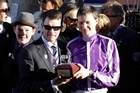 Trainer Aidan O'Brien (L) poses with his son and jockey Joseph O'Brien. Photo / Getty Images