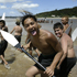 2004: Children head for a waka off the beach by Te Tii marae. Photo / Richard Robinson