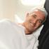 Rob Fyfe sleeps on a Skycouch on the Air New Zealand Boeing 777-300 ER plane. Photo / Janna Dixon