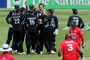 The Black Caps celebrate after taking an early Zimbabwe wicket. Photo / Getty Images