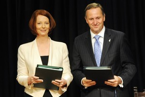 Australian Prime Minister Julia Gillard and New Zealand Prime Minister John Key last year signed an agreement to increase investment between the two countries. Photo / NZPA - Ross Setford