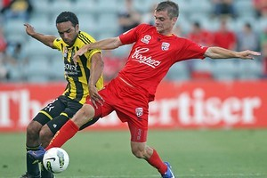 Paul Ifill (L) of Wellington competes with Cameron Watson (R) of Adelaide. Photo / Getty Images