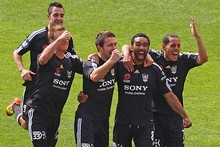 Paul Ifill of the Phoenix celebrates with his team after scoring against the Melbourne Heart. Photo / Getty Images