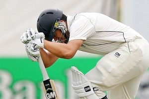 Ross Taylor reacts after an injury. Photo / Getty Images