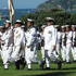 2011: New Zealand Navy sailors line up with the frigate Te Kaha anchored behind them in the Bay of Islands on Waitangi Day. Photo / Peter de Graaf