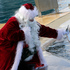 A man dressed in Santa Claus feeds a killer whale (Orcinus orca) named 'Valentin', at the animal exhibition park Marineland in Antibes, southern France. Photo / AP